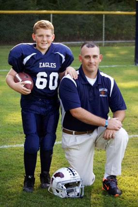 Greg coaches his son's football team